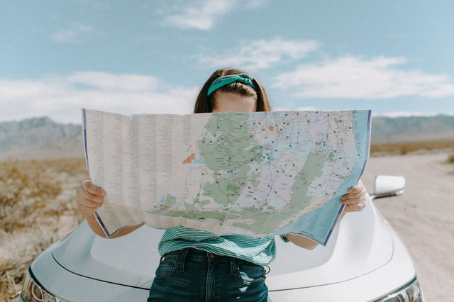 Women looking at a map driving to the next national park in Arizona