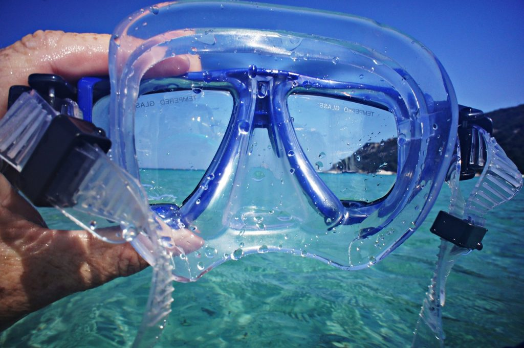 snorkeling mask in the blue waters of the US Virgin Islands
